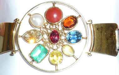 closeup of crystal healing chakra design bangle