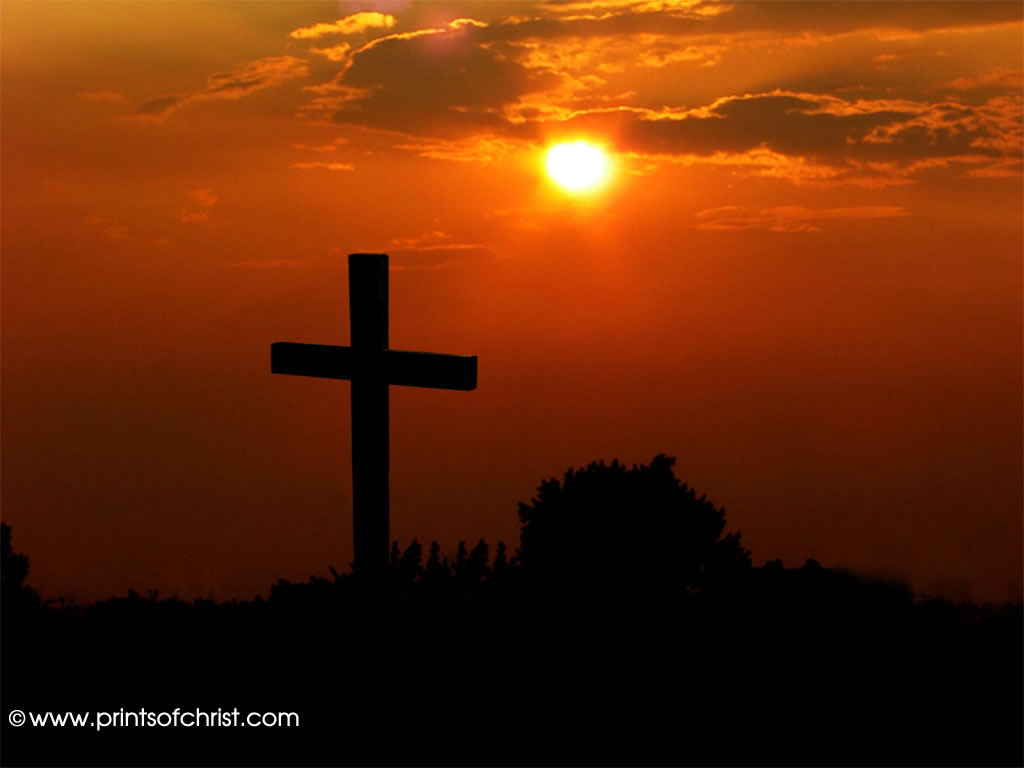 crucifix at sunset background