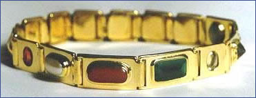 gemstone therapy bracelet or bangle, also known as a Navaratna or nine gem bangle. Although this one is set in gold, we also set many in silver.