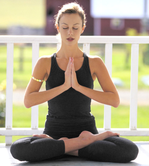 woman meditating with gem bangle