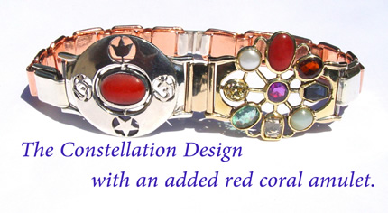constellation design with added red coral amulet
