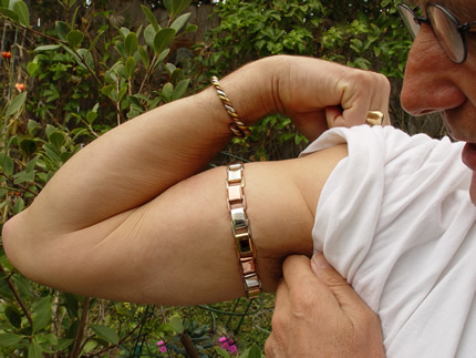 man wearing two metal bangles