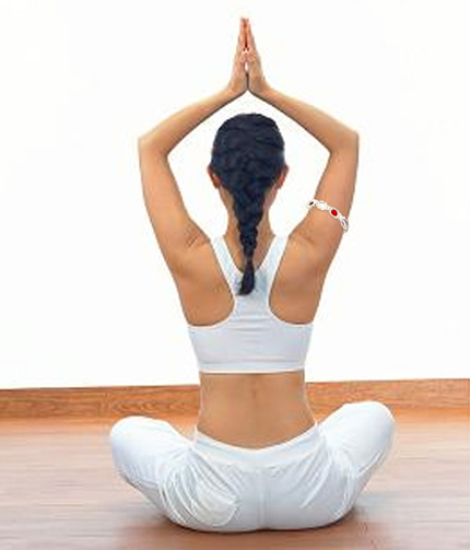 woman practicing yoga wearing gem bangle